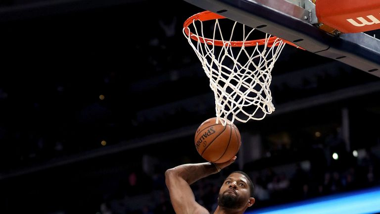 Paul George rams home a dunk against the Denver Nuggets