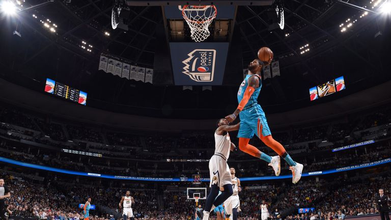 Paul George soars for an emphatic dunk in Denver