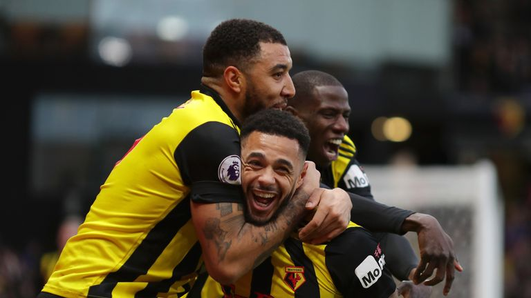 Andre Gray celebrates his goal with team-mate Troy Deeney at Vicarage Road
