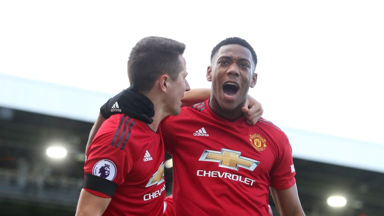 Anthony Martial celebrates with Ander Herrera