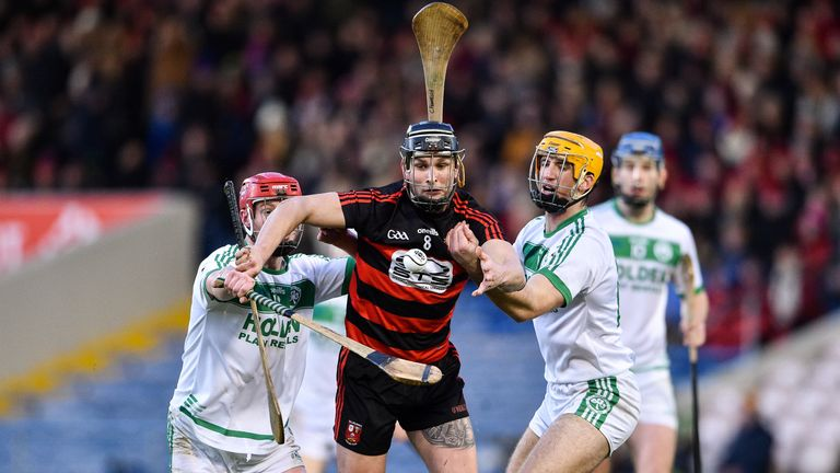 Harley Barnes of Ballygunner in action against Adrian Mullen and Colin Fennelly of Ballyhale Shamrocks