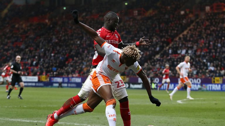 Blackpool's Armand Gnanduillet is challenged by Charlton's Naby Sarr during the Sky Bet League One clash