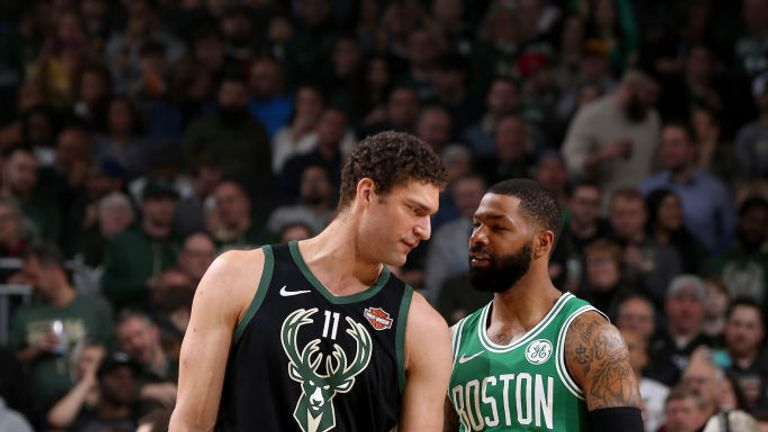 Brook Lopez of the Milwaukee Bucks and Marcus Morris of the Boston Celtics share a moment