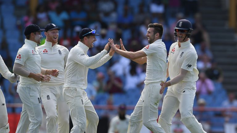 Mark Wood celebrates a wicket with team-mate Jos Buttler