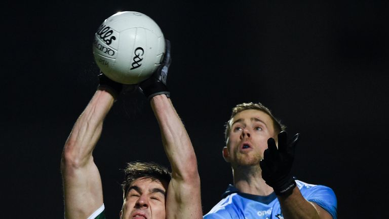 Brian Ó Beaglaíoch and Paul Mannion compete for possession