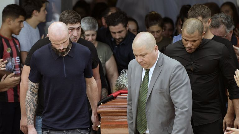 Nantes' French defender Nicolas Pallois (L) and relatives of late Argentine footballer Emiliano Sala carry his coffin during the funeral