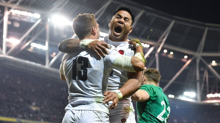 Manu Tuilagi and Henry Slade celebrating on the field in Dublin