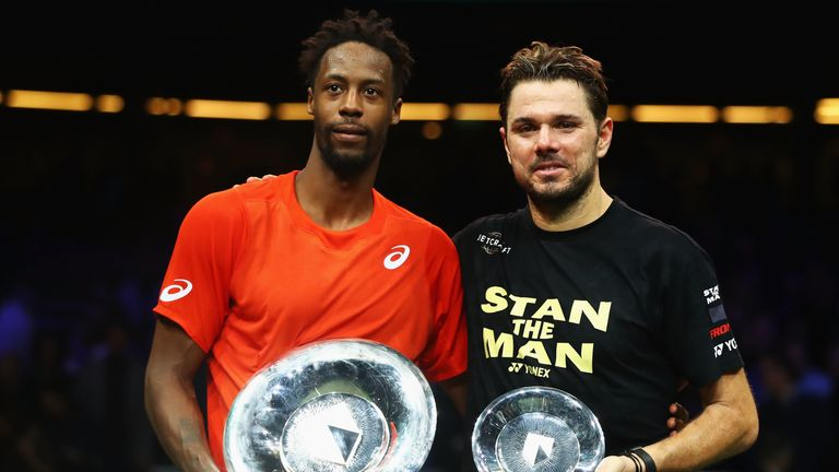 Monfils and Wawrinka pose with their trophies after a thrilling final