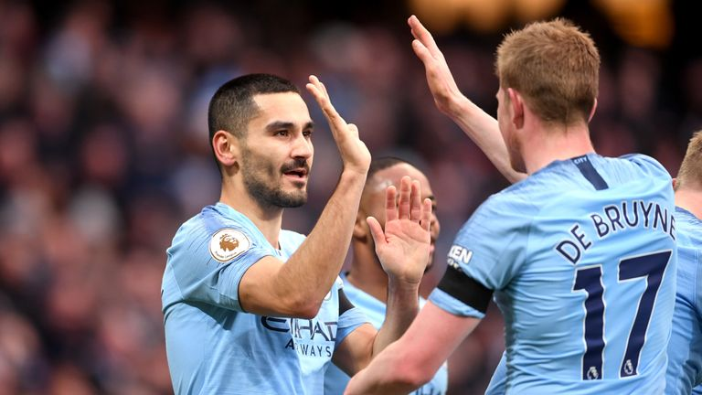 Ilkay Gundogan celebrates scoring Manchester City's fourth against Chelsea