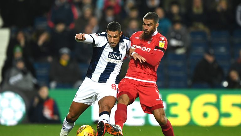 Lewis Grabban and Jake Livermore battle for the ball