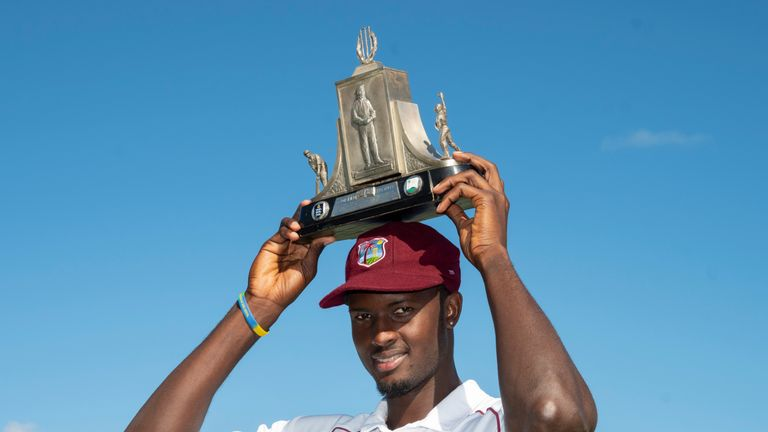Windies captain Jason Holder shows off the Wisden Trophy after winning the series against England