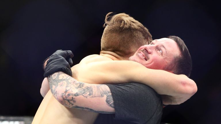 Brad Katona of Canada celebrates with coach John Kavanagh after victory against Matthew Lopez of the United States in a bantamweight bout during the UFC 231 event at Scotiabank Arena on December 8, 2018 in Toronto, Canada.