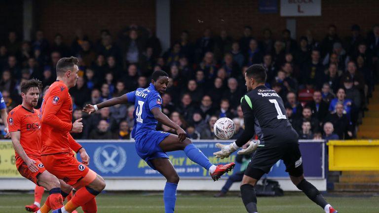 Millwall goalkeeper Jordan Archer saves a shot