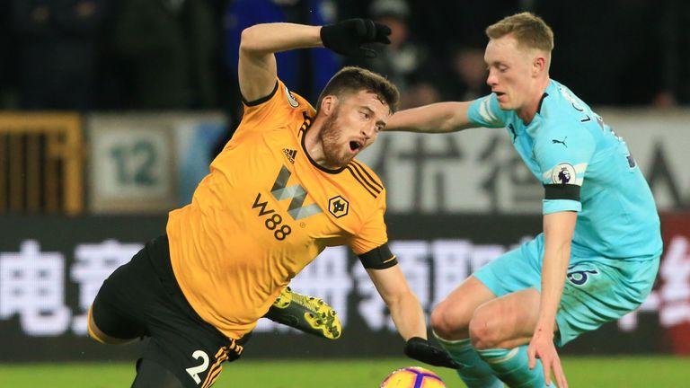 Matt Doherty goes down under a challenge from Sean Longstaff