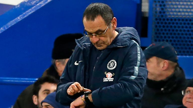 Maurizio Sarri looks at his watch during Chelsea's FA Cup defeat to Manchester United at Stamford Bridge in February 2019