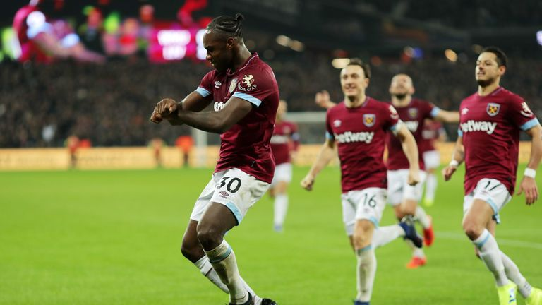 Michail Antonio celebrates hauling the Hammers level in the first half