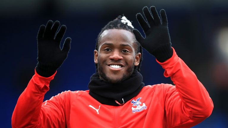 Loan signing Michy Batshuayi acknowledges the fans as he warms up