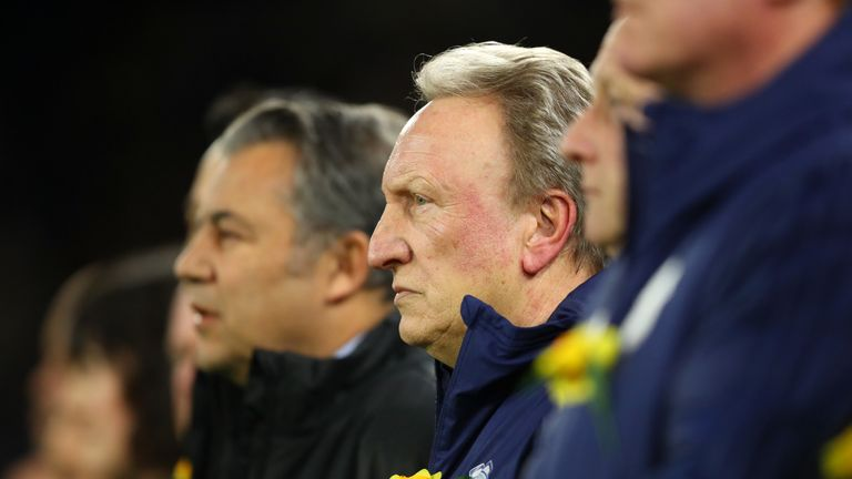 Neil Warnock and Cardiff City backroom staff observe a minute's silence in honour of Emiliano Sala