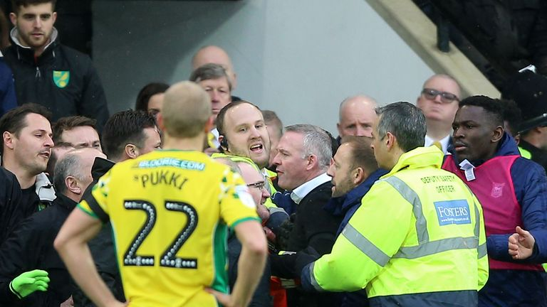 Lambert was held back by police and stewards after an altercation on the touchline