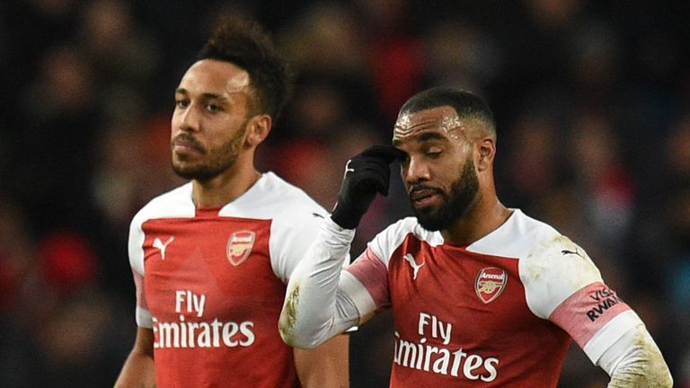 Pierre-Emerick Aubameyang and Alexandre Lacazette looked dejected as Arsenal were beaten by Man City