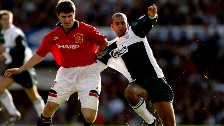 Roy Keane and Phil Babb in action during a memorable Premier League encounter