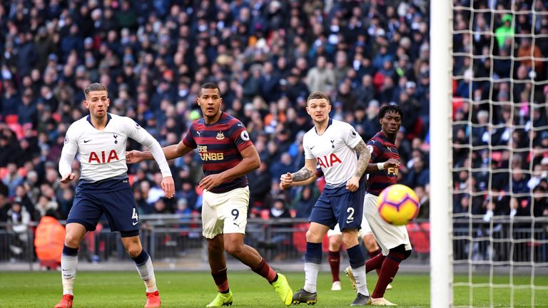 Tottenham and Newcastle players look on as Salomon Rondon's shot hits the post