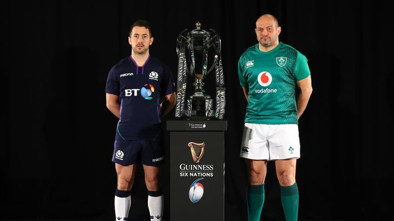 Scotland's Greig Laidlaw and Ireland's Rory Best pose with the Six Nations trophy
