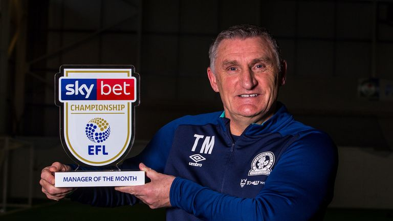 Tony Mowbray shows off his award