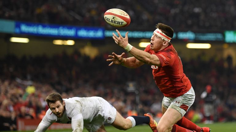 Wales' Josh Adams catches the ball before diving over to score against England in Cardiff