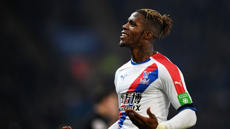 Wilfried Zaha celebrates firing Crystal Palace back in front against Leicester