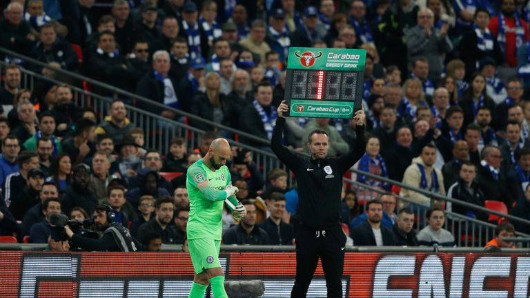 Caballero waits for Kepa to leave the pitch after his number is raised by the fourth official