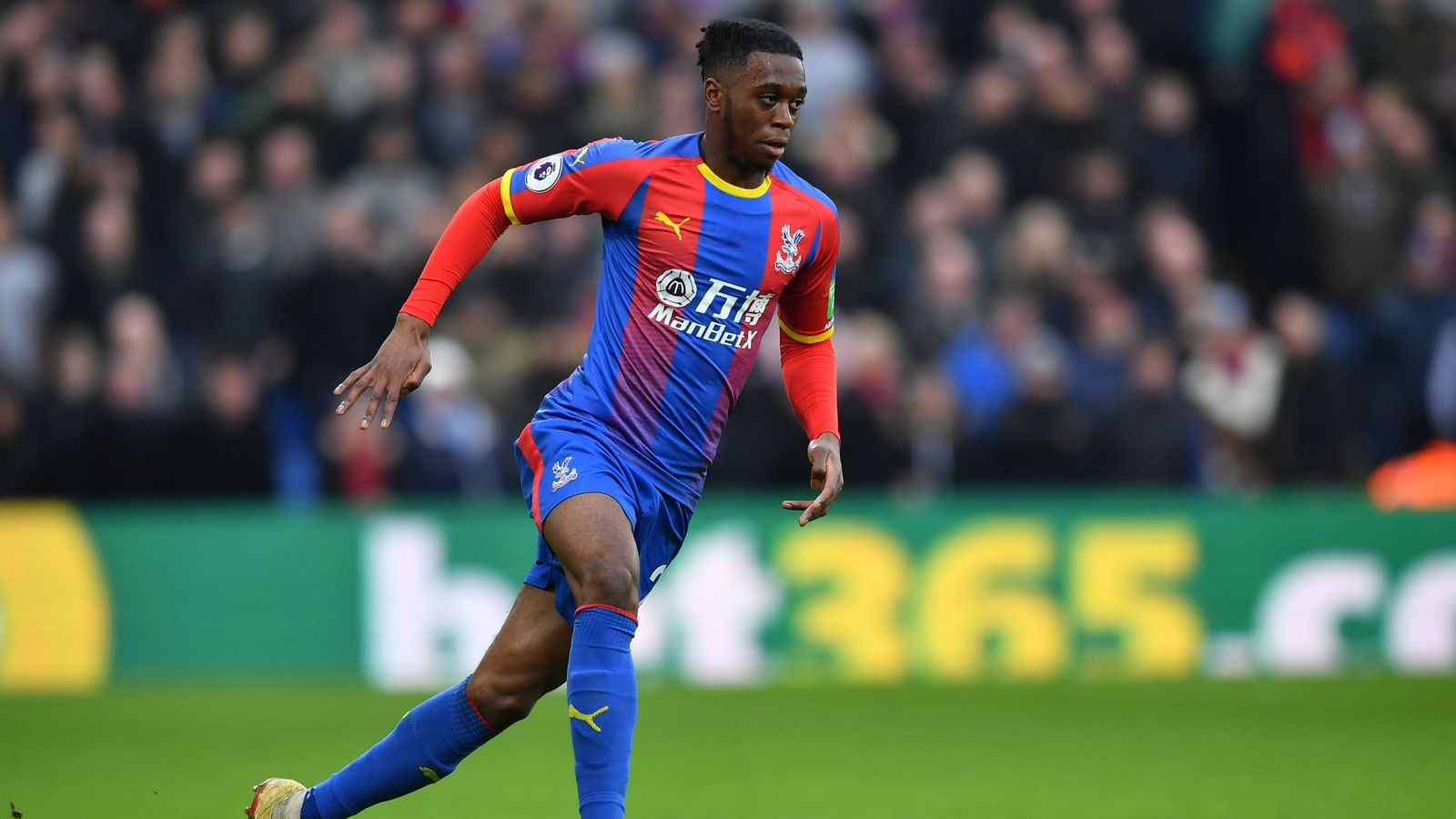 Manchester United's Aaron Wan-Bissaka talks with Crystal Palace progressing