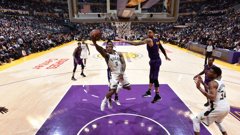 Eric Bledsoe powers his way to the hoop against the Lakers