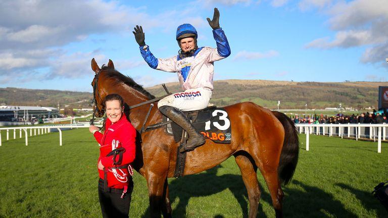 Jockey Harry Skelton celebrates winning the OLBG Mares' Hurdle with Roksana