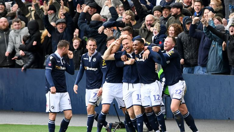 Alex Pearce celebrates scoring for Millwall against Brighton