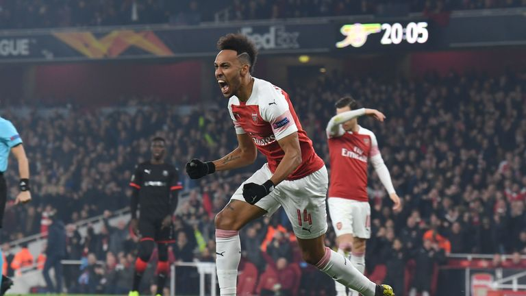 Pierre-Emerick Aubameyang celebrates the opener against Rennes at the Emirates