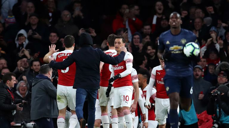Police have charged a man with common assault and invading the pitch at the Emirates