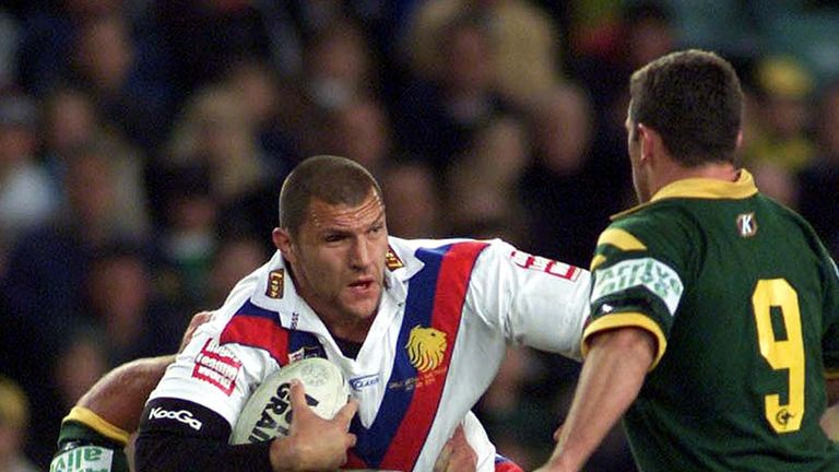 Barrie McDermott of the Lions tries to break through Shane Webcke of the Kangaroos