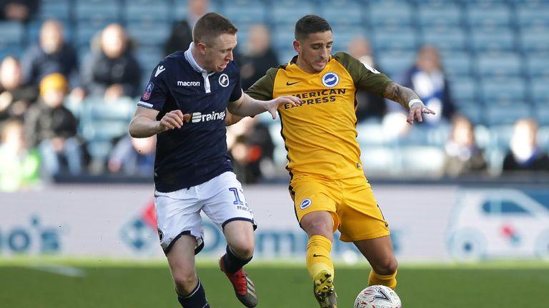 Shane Ferguson (L) battles for possession with Brighton midfielder Anthony Knockaert