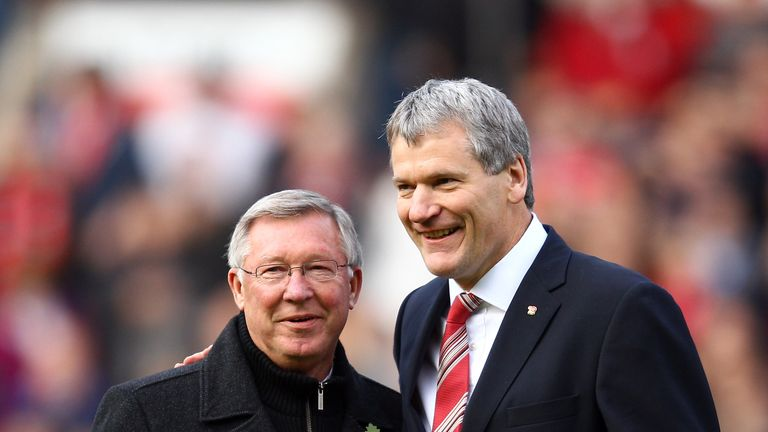 David Gill and Sir Alex Ferguson on the pitch at Old Trafford