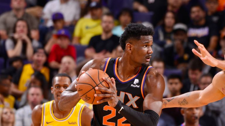 Deandre Ayton #22 of the Phoenix Suns looks to pass the ball during the game against JaVale McGee #7 of the Los Angeles Lakers on March 2, 2019 at Talking Stick Resort Arena in Phoenix, Arizona.