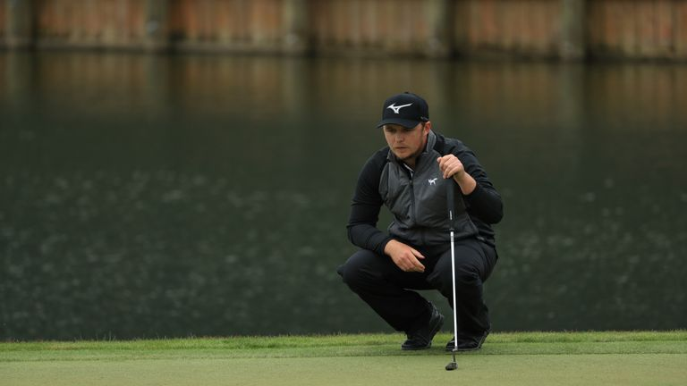 Pepperell lines up a putt at the 18th during the final round of The Players Championship