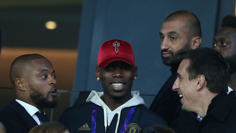 Patrice Evra (left) attended Manchester United's win over PSG in Paris this month