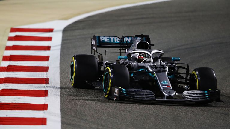 Lewis Hamilton overtakes a limping Charles Leclerc to take the lead at the Bahrain GP