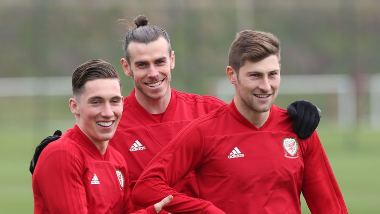 Harry Wilson (left) has 11 caps for Ryan Giggs' Wales