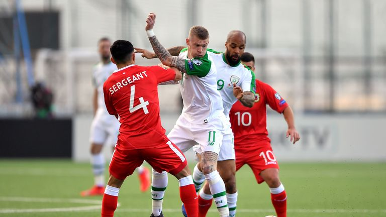 Gibraltar's John Sergeant and Republic's James McClean battle for the ball