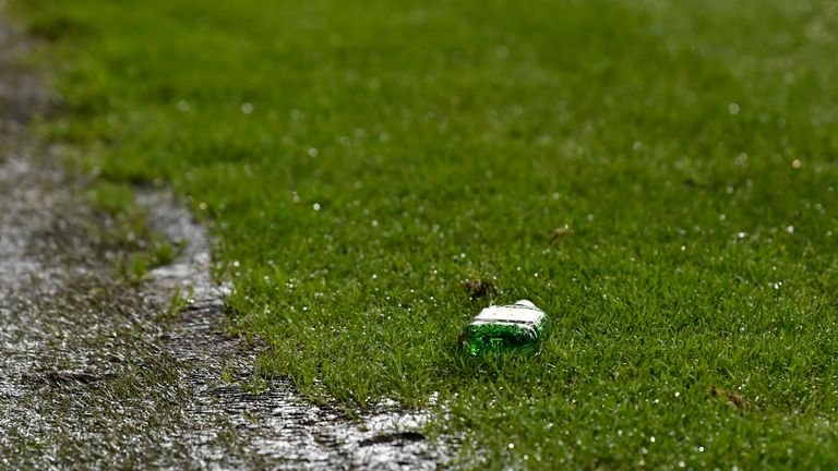 The bottle was thrown in the direction of Scott Sinclair as he took a corner