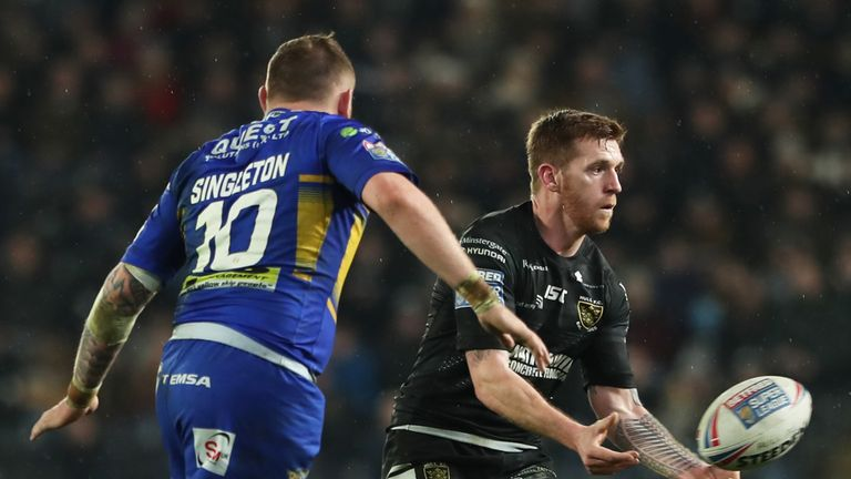 Marc Sneyd passes the ball as Brad Singleton of Leeds Rhinos approaches