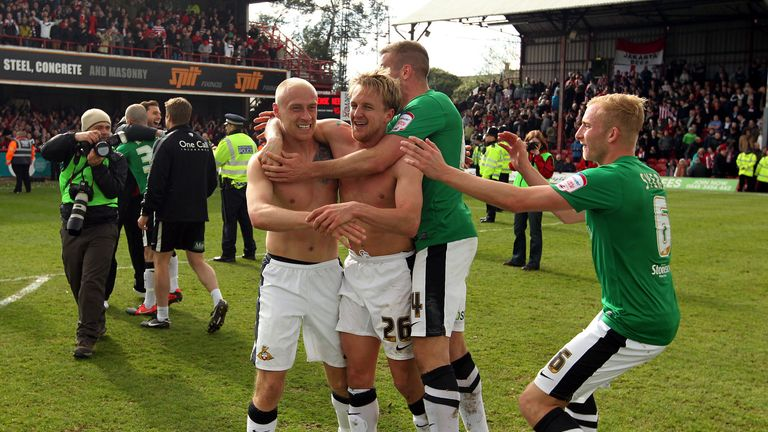 Coppinger celebrates with his team-mates after their remarkable win over Brentford in 2013
