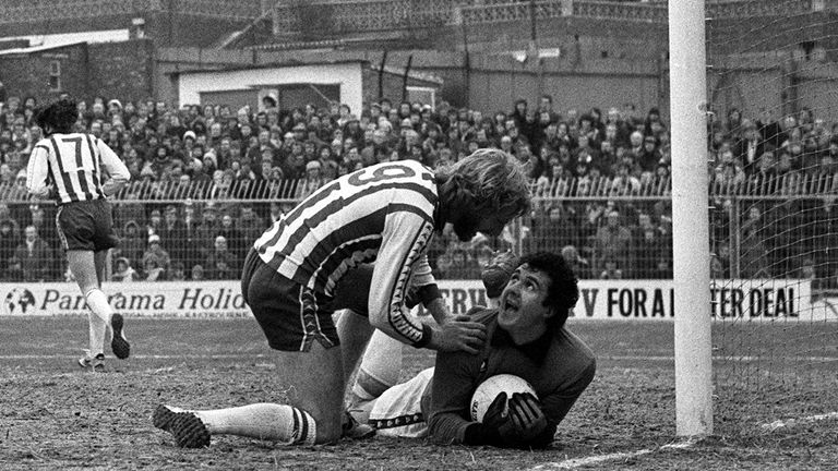 John Burridge's expression says it all as Brighton's Teddy Maybank has a word in a 1979 match